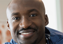 African American male nurse smiling and facing the camera